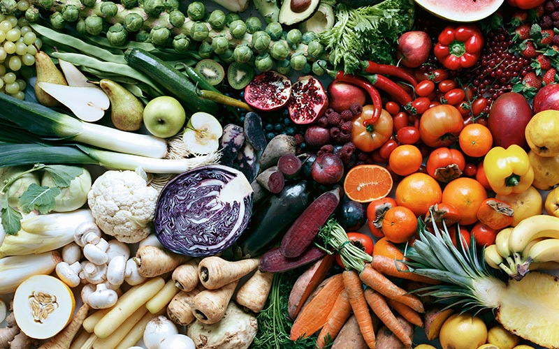 A platter of veg and fruits in season in a rainbow of colors