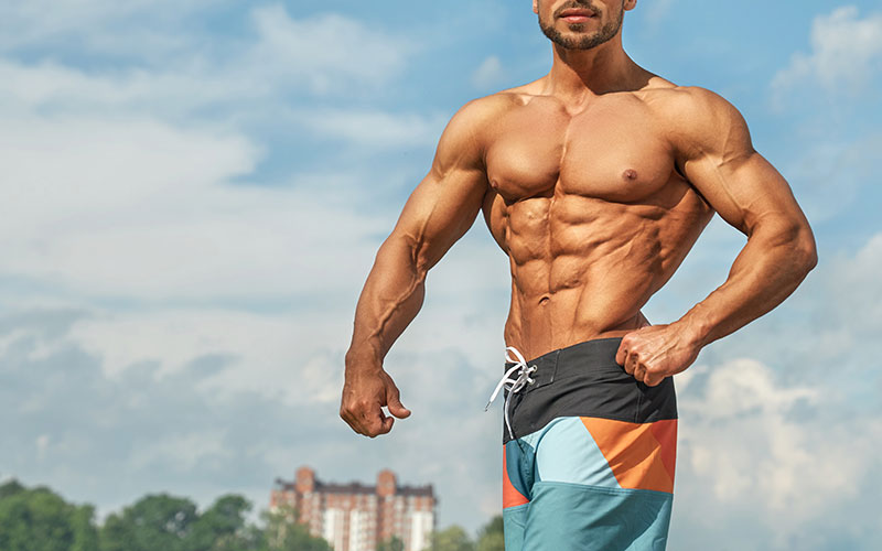 Image of the shirtless torso of a man who likely participates in natural bodybuilding