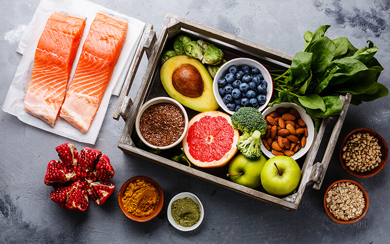 a view from above of a selection of foods well suited for clean eating