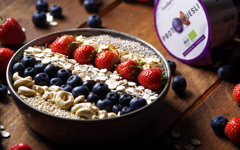 A bowl of protein muesli with berries
