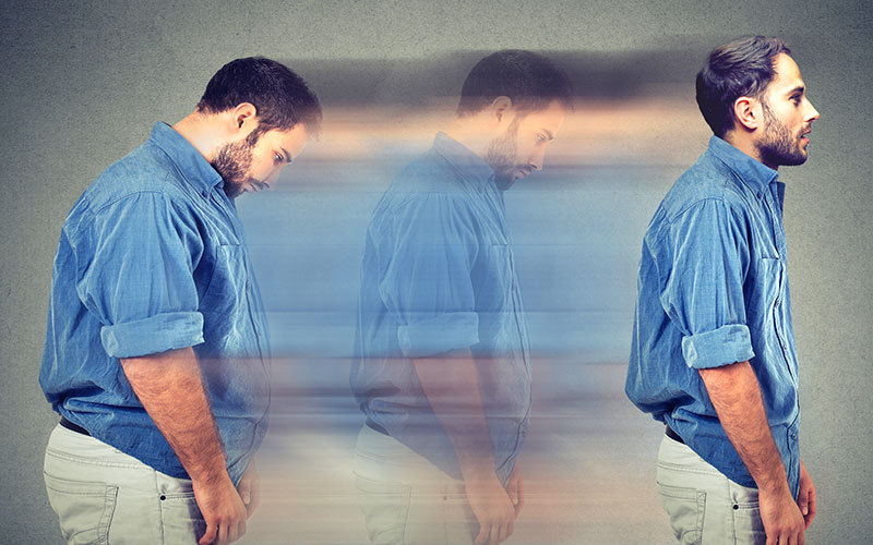A man is shown on the left of the picture hunched forward, blurred toward his right-side image, as he completes healthy weight loss