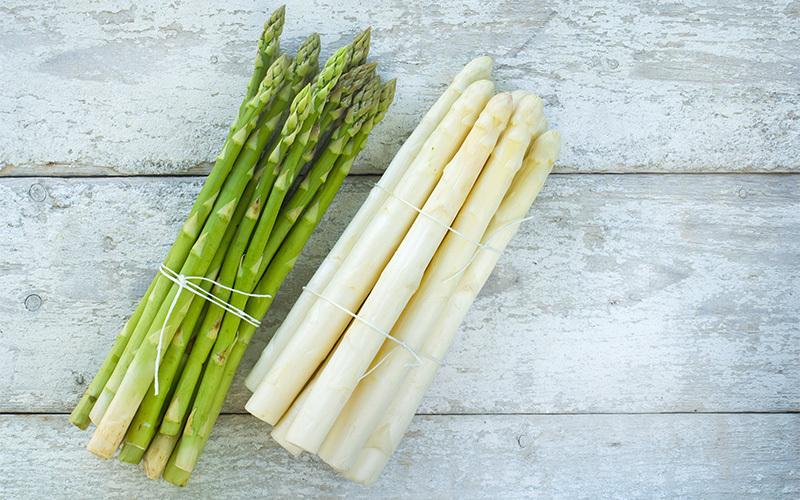is asparagus healthy? bundles of white and green asparagus