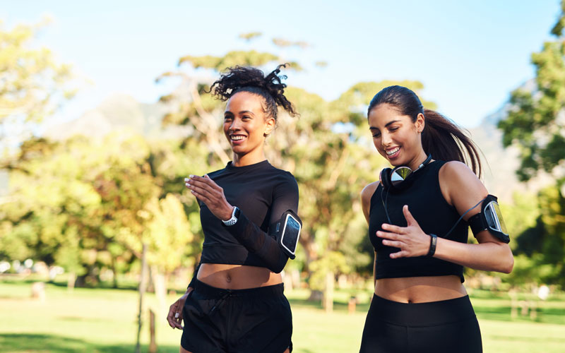 Two women of different skin colors do strength training for runners