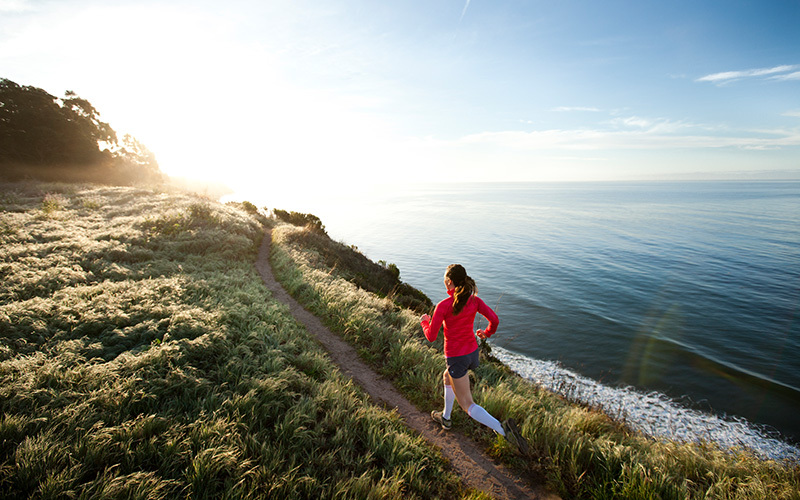 How to motivate yourself to exercise? Try taking a run outside like the person in this photo.