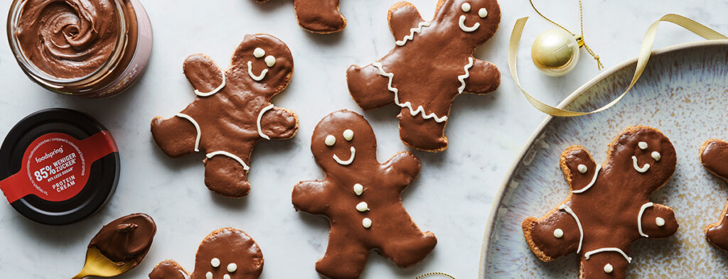 a plate of gingerbread cookies in gingerbread man shapes