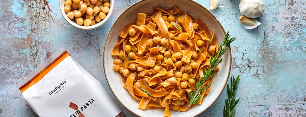 a bowl of protein pasta with chickpeas as seen from above.