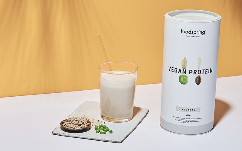 A photo of foodspring's Vegan Protein, containing pea protein, rice protein, hemp protein, and sunflower protein