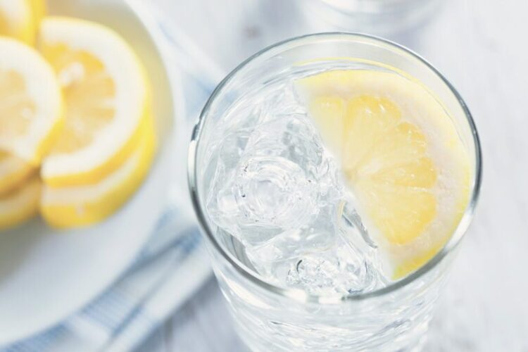 a glass of water with a lemon slice: add salt and juice to make isotonic drinks