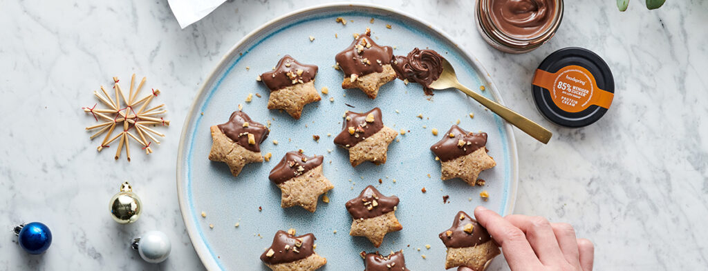 Low Carb Cookies dipped in chocolatey protein cream