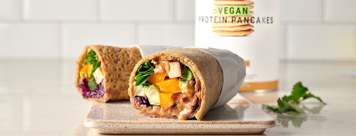 Two Vegan Rainbow Wraps showing their bright insides with a rainbow of colorful fillings