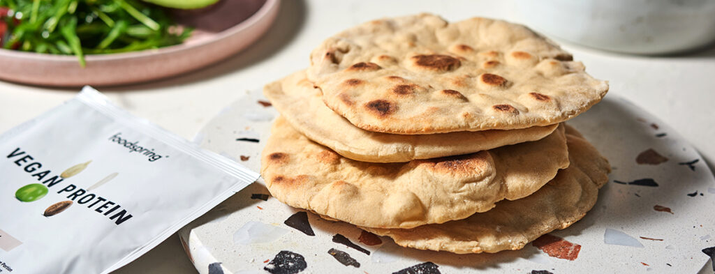 Four pockets of pita bread in a stack with lovely darkened brown spots