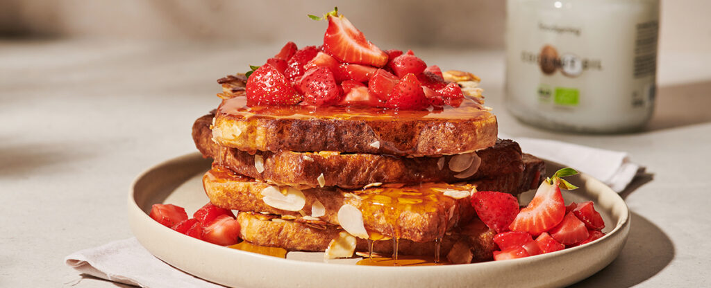 A plate of almond French toast with strawberries