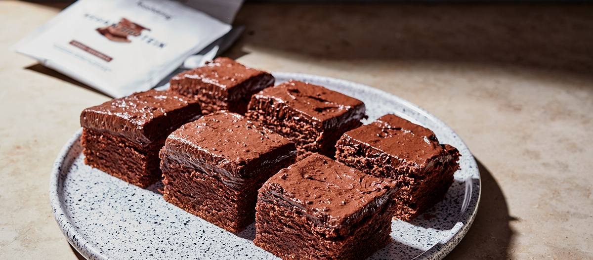 a black-speckled gray plate with beet brownies with sharp-cut edges