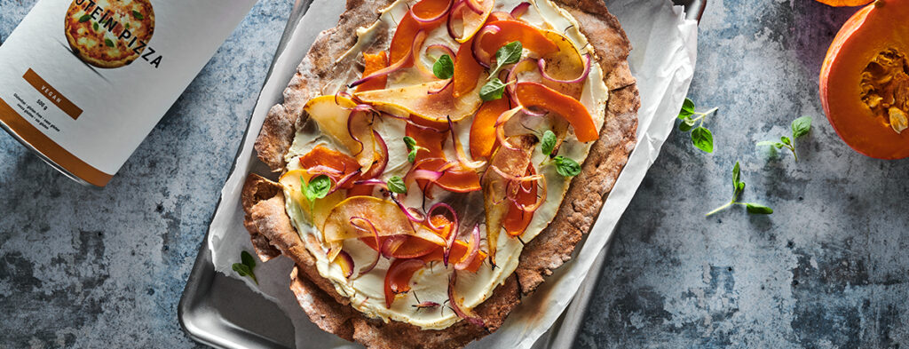 a protein tarte flambee topped with paper-thin slices of red